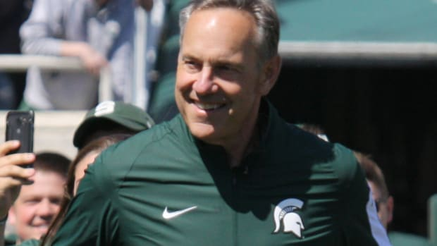 Mark Dantonio running out for the 2016 spring football game.  Photo courtesy of Mark Boomgaard.