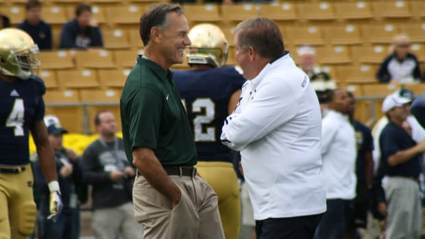 Brian Kelly Notre Dame head coach and Mark Dantonio visit prior to the 2013 game in South Bend.  Photo courtesy of Mark Boomgaard.