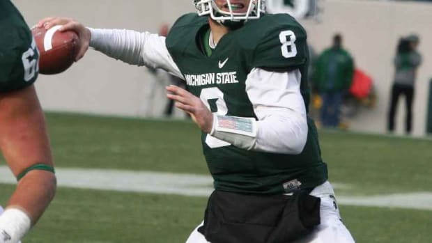 The health of Kirk Cousins is the biggest story for the Spartans on Saturday.  Photo courtesy of Bill Marklevits.