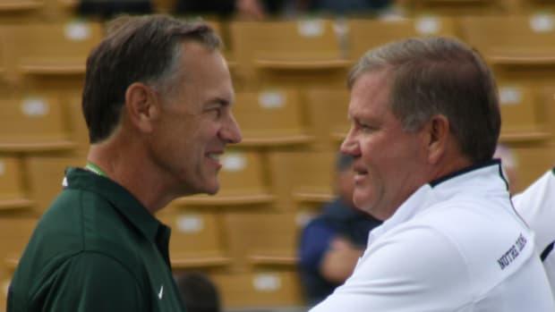 Mark Dantonio and Brian Kelly visit prior to the MSU vs Notre Dame contest in 2013.  Photo courtesy of Mark Boomgaard.
