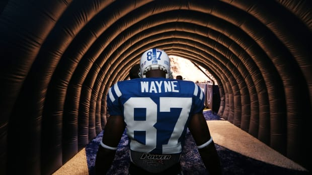 Indianapolis Colts wide receiver Reggie Wayne prepares to enter the field before a game in his final season in 2014 at Lucas Oil Stadium.
