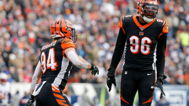 Cincinnati Bengals defensive end Carlos Dunlap (96) and defensive end Sam Hubbard (94) celebrate a strop in the first quarter of the NFL Week 15 game between the Cincinnati Bengals and the New England Patriots at Paul Brown Stadium in downtown Cincinnati on Sunday, Dec. 15, 2019. The Patriots led 13-10 at the half. New England Patriots At Cincinnati Bengals