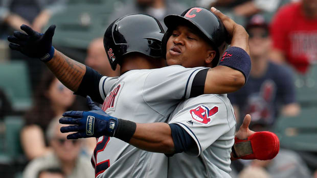 Jun 14, 2018; Chicago, IL, USA; Cleveland Indians third baseman Jose Ramirez (11) celebrates with teammate Cleveland Indians shortstop Francisco Lindor (12) after hitting a two-run home run against the Chicago White Sox during the seventh inning at Guaranteed Rate Field.