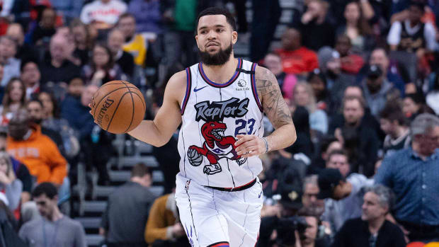 Toronto Raptors guard Fred VanVlett dribbles up the court