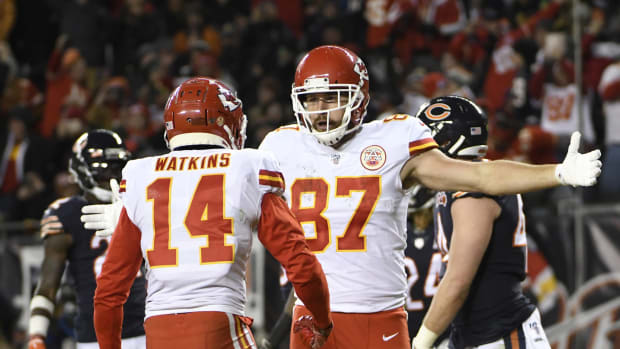 Dec 22, 2019; Chicago, Illinois, USA; Kansas City Chiefs tight end Travis Kelce (87) celebrates with wide receiver Sammy Watkins (14) after scoring a touchdown against the Chicago Bears during the first half at Soldier Field. Mandatory Credit: David Banks-USA TODAY Sports