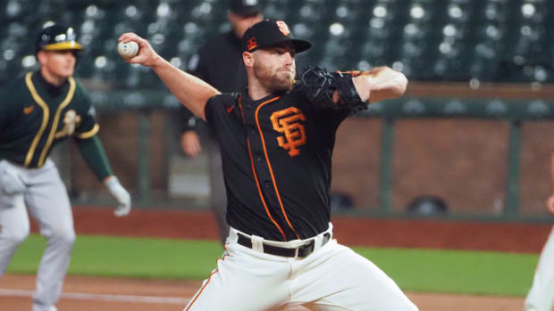 Giants reliever Sam Coonrod delivers a pitch