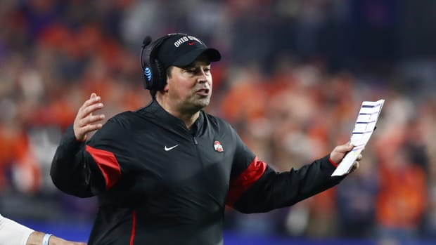 Ryan Day arms extended in frustration