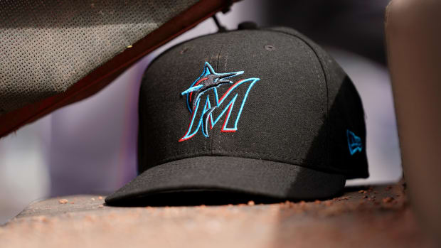 A view of a New Era Miami Marlins hat in the dugout during the game against the Cincinnati Reds at Great American Ball Park