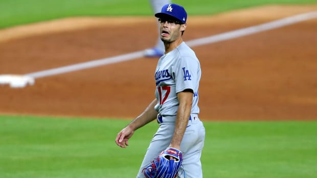Jul 28, 2020; Houston, Texas, USA; Los Angeles Dodgers relief pitcher Joe Kelly (17) shouts at Houston Astros shortstop Carlos Correa (1, not shown) after a strikeout during the sixth inning at Minute Maid Park.