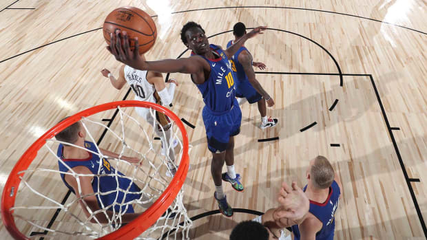 Bol Bol of the Nuggets grabs the rebound against the Pelicans