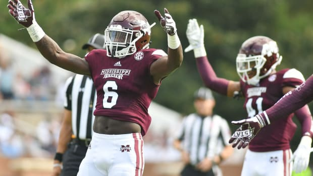 Sep 2, 2017; Starkville, MS, USA; Mississippi State Bulldogs linebacker Willie Gay Jr (6) pumps up the crowd during the game against the Charleston Southern Buccaneers. at Davis Wade Stadium. Mandatory Credit: Matt Bush-USA TODAY Sports