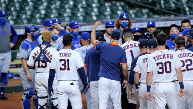 Members of the Los Angeles Dodgers and Houston Astros benches converge after a strikeout to end the sixth inning at Minute Maid Park.