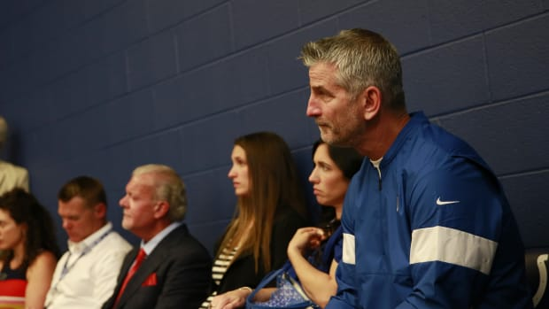 Indianapolis Colts head coach Frank Reich (far right) listens as quarterback Andrew Luck announces his retirement in 2019.