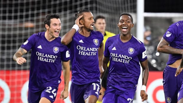 Orlando City SC forward Nani (17) celebrates with teammates after scoring the game winning penalty kick to defeat the Los Angeles FC at ESPN Wide World of Sports Complex.