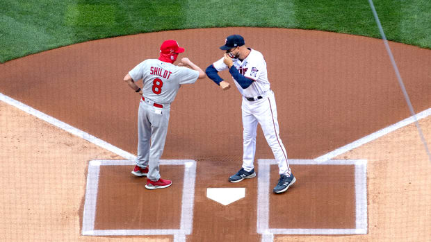 St. Louis Cardinals manager Mike Shildt (8) touches elbows with Minnesota Twins manger Rocco Baldelli (5) prior to the game at Target Field.