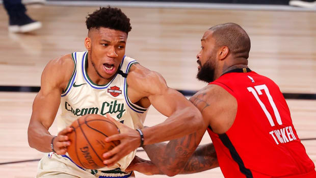 Milwaukee Bucks forward Giannis Antetokounmpo goes up for a shot against Houston Rockets forward P.J. Tucker at The Arena at ESPN Wide World Of Sports Complex on Sunday in Lake Buena Vista, Fla.