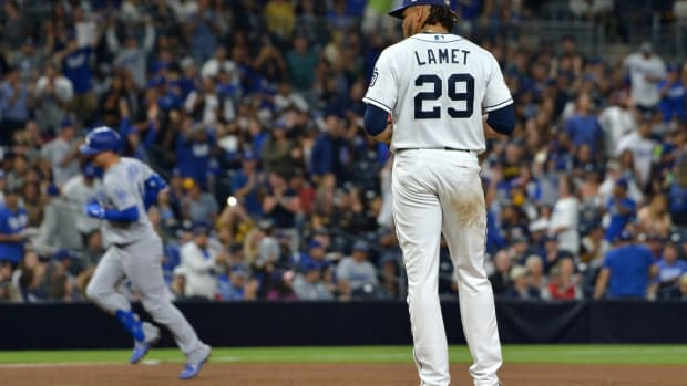 Sep 25, 2019; San Diego, CA, USA; San Diego Padres starting pitcher Dinelson Lamet (29) reacts after giving up a solo home run to Los Angeles Dodgers right fielder Joc Pederson (background) during the fifth inning at Petco Park. Mandatory Credit: Jake Roth-USA TODAY Sports