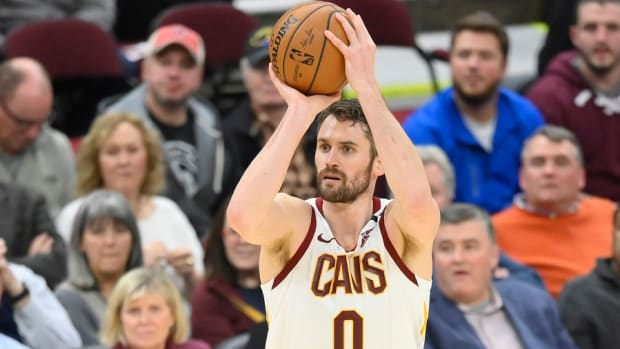 Cleveland Cavaliers forward Kevin Love shoots a a 3-pointer against the Toronto Raptors at Rocket Mortgage FieldHouse.