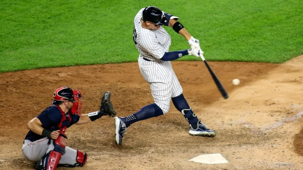 Yankees' Aaron Judge makes contact with a pitch vs. Red Sox