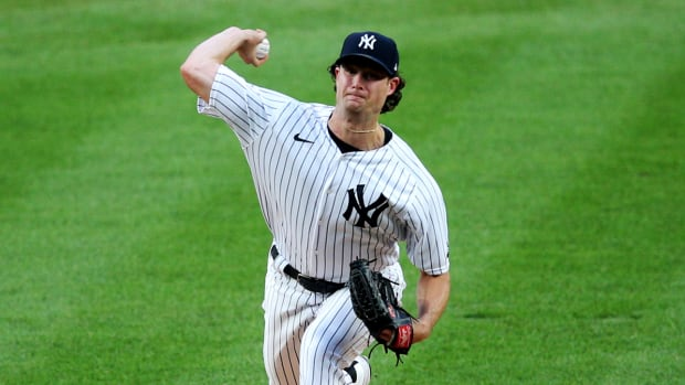 Aug 3, 2020; Bronx, New York, USA; New York Yankees starting pitcher Gerrit Cole (45) pitches against the Philadelphia Phillies during the first inning at Yankee Stadium.