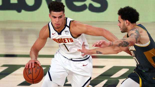 Denver Nuggets forward Michael Porter Jr. handles the ball against Oklahoma City Thunder forward Abdel Nader