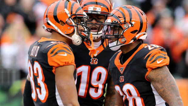 Cincinnati Bengals wide receiver Tyler Boyd (83)m left, is congratulated by Cincinnati Bengals running back Joe Mixon (28) and Cincinnati Bengals wide receiver Auden Tate (19) and scoring a touchdown during the first quarter of a Week 13 NFL game against the New York Jets, Sunday, Dec. 1, 2019, at Paul Brown Stadium in Cincinnati. New York Jets At Cincinnati Bengals 12 1 2019