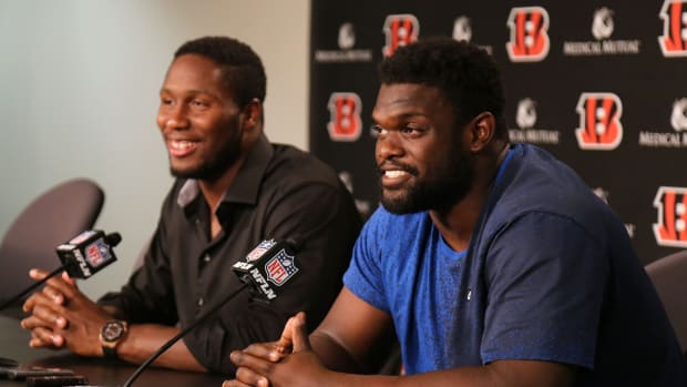 Cincinnati Bengals defensive tackle Geno Atkins, right, and defensive end Carlos Dunlap answer questions after they both signed contract extensions with the team, Wednesday at Paul Brown Stadium. Geno Atkins Carlos Dunlap Contract Extensions Aug 29