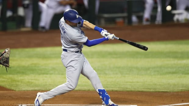 Jul 30, 2020; Phoenix, Arizona, USA; Los Angeles Dodgers outfielder AJ Pollock hits a two run home run in the first inning against the Arizona Diamondbacks during the home opener at Chase Field. Mandatory Credit: Mark J. Rebilas-USA TODAY Sports