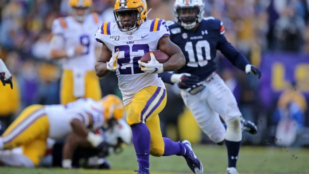 Oct 26, 2019; Baton Rouge, LA, USA; LSU Tigers running back Clyde Edwards-Helaire (22) breaks a long run in the second half against the Auburn Tigers at Tiger Stadium. Mandatory Credit: Chuck Cook-USA TODAY Sports