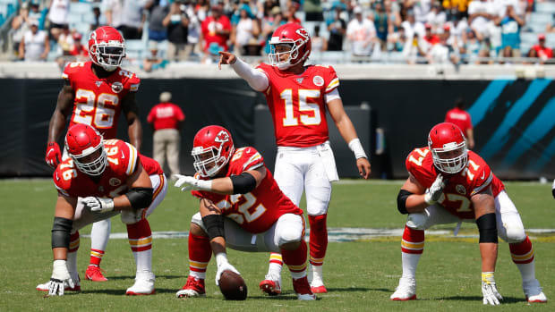 Sep 8, 2019; Jacksonville, FL, USA; Kansas City Chiefs quarterback Patrick Mahomes (15) audibles coverage as running back Damien Williams (26) and offensive guard Laurent Duvernay-Tardif (76) and offensive guard Andrew Wylie (77) and center Austin Reiter (62) listen during the second quarter against the Jacksonville Jaguars at TIAA Bank Field. Mandatory Credit: Reinhold Matay-USA TODAY Sports