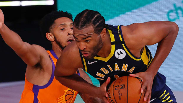 T.J. Warren #1 of the Indiana Pacers drives against Cameron Payne #15 of the Phoenix Suns at Visa Athletic Center.