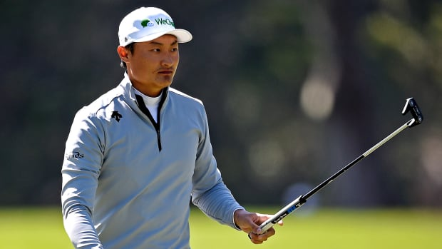 Haotong Li reacts to his putt on the 14th green during the second round of the 2020 PGA Championship golf tournament at TPC Harding Park.
