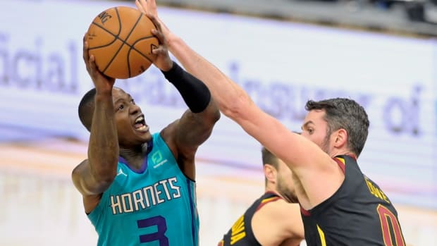 Charlotte Hornets guard Terry Rozier shoots against Cleveland Cavaliers forward Kevin Love during a game at Rocket Mortgage FieldHouse in December.