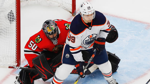 Edmonton Oilers forward Alex Chiasson (39) tries to screen Chicago Blackhawks goaltender Corey Crawford (50) during the third period in the Western Conference qualifications at Rogers Place.