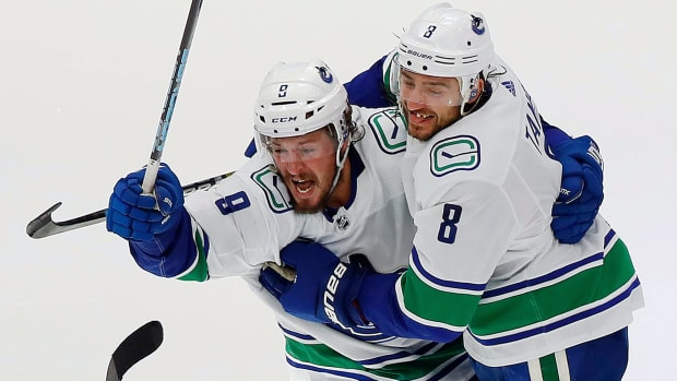 The Vancouver Canucks defensemen Chris Tanev (8) celebrates after scoring the series winning goal against the Minnesota Wild in over time during the Western Conference qualifications at Rogers Place.