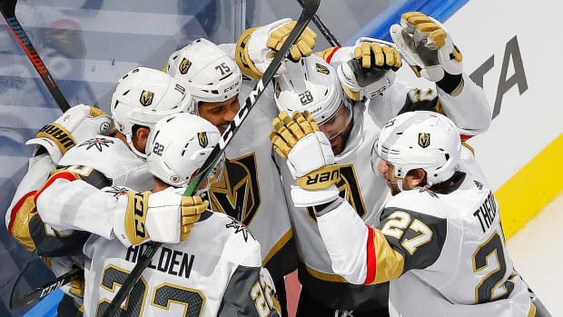 The Vegas Golden Knights celebrate a second period goal by forward Nicolas Hague (10) against the Colorado Avalanche during the Western Conference qualifications at Rogers Place.