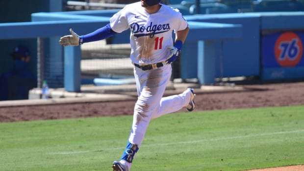 August 9, 2020; Los Angeles, California, USA; Los Angeles Dodgers designated hitter A.J. Pollock (11) rounds the bases after hitting a three run home run during the seventh inning against the San Francisco Giants at Dodger Stadium. Mandatory Credit: Gary A. Vasquez-USA TODAY Sports