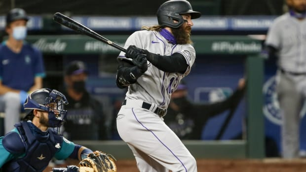 Aug 7, 2020; Seattle, Washington, USA; Colorado Rockies right fielder Charlie Blackmon (19) hits a single against the Seattle Mariners during the third inning at T-Mobile Park. Mandatory Credit: Joe Nicholson-USA TODAY Sports
