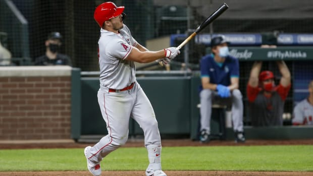 Aug 5, 2020; Seattle, Washington, USA; Los Angeles Angels center fielder Mike Trout (27) hits a three-run home run against the Seattle Mariners during the eighth inning at T-Mobile Park. Mandatory Credit: Joe Nicholson-USA TODAY Sports