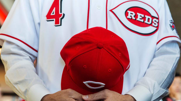 Cincinnati Reds baseball uniform and cap