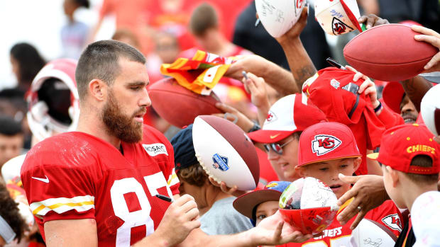Jul 29, 2018; St. Joseph, MO, USA; Kansas City Chiefs tight end Travis Kelce (87) signs autographs for fans after training camp at Missouri Western State University. Mandatory Credit: Denny Medley-USA TODAY Sports