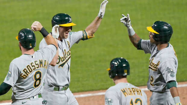 Oakland A's players celebrate Stephen Piscotty's game-tying grand slam against the San Francisco Giants.