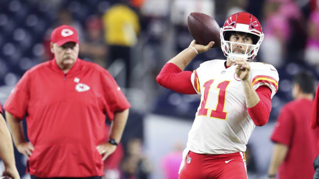 Oct 8, 2017; Houston, TX, USA; Kansas City Chiefs quarterback Alex Smith (11) throws in front of head coach Andy Reid before the game against the Houston Texans at NRG Stadium. Mandatory Credit: Kevin Jairaj-USA TODAY Sports