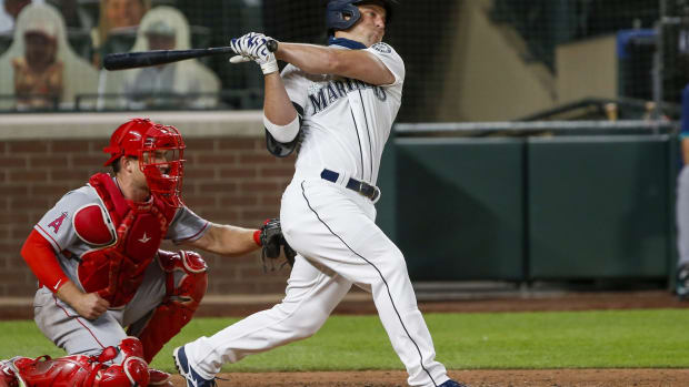 Aug 5, 2020; Seattle, Washington, USA; Seattle Mariners third baseman Kyle Seager (15) hits a single against the Los Angeles Angels during the seventh inning at T-Mobile Park. Mandatory Credit: Joe Nicholson-USA TODAY Sports