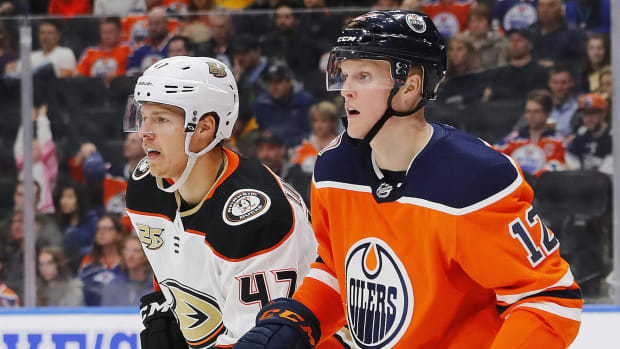 Mar 30, 2019; Edmonton, Alberta, CAN; Anaheim Ducks defensemen Hampus Lindholm (47) and Edmonton Oilers forward Colby Cave (12)  follow the play during the third period at Rogers Place. Mandatory Credit: Perry Nelson-USA TODAY Sports