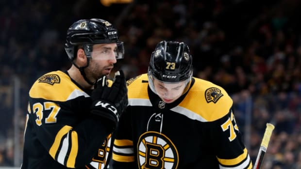 Patrice Bergeron and Charlie McAvoy