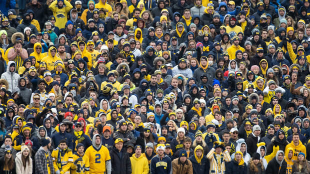 Michigan football fans at packed stadium