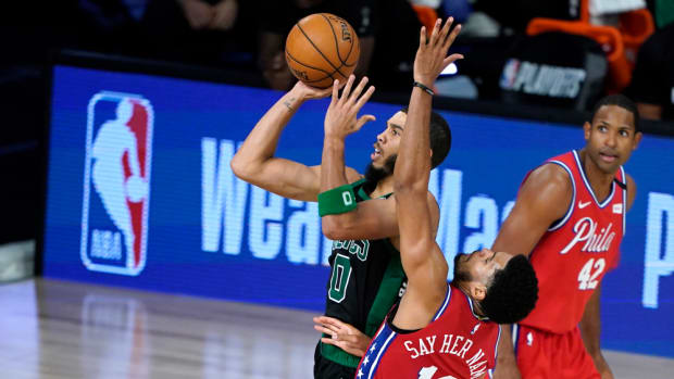 Celtics forward Jayson Tatum drives to the basket against the Philadelphia 76ers during Game 1 of their Eastern Conference playoff series on the Disney campus.