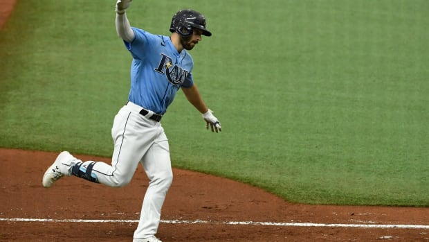 Aug 9, 2020; St. Petersburg, Florida, USA; Tampa Bay Rays second baseman Brandon Lowe (8) reacts after hitting a home run to tie the game 3-3 during the seventh inning against the New York Yankees at Tropicana Field. Mandatory Credit: Douglas DeFelice-USA TODAY Sports