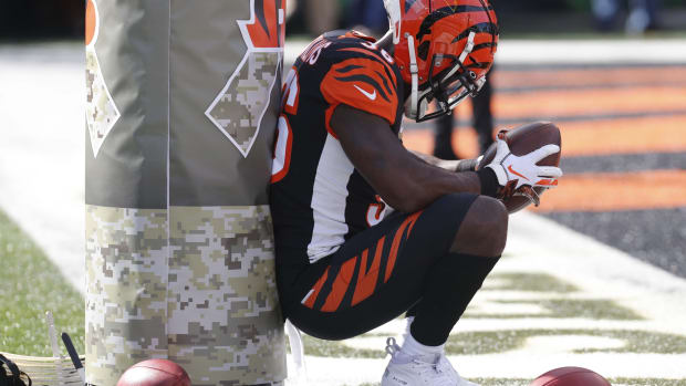 Nov 10, 2019; Cincinnati, OH, USA; Cincinnati Bengals strong safety Shawn Williams (36) sits at the goal post before a game against the Baltimore Ravens at Paul Brown Stadium. Mandatory Credit: David Kohl-USA TODAY Sports